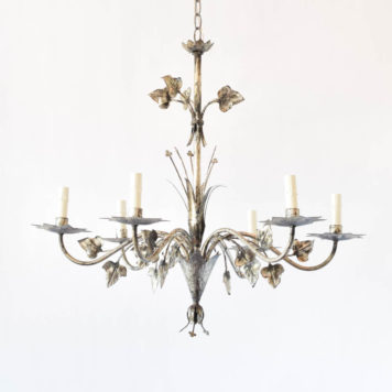 Iron chandelier from Barcelona with stamped ivy leaves and clovers surrounded by 6 arms