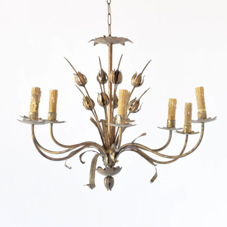 Vintage iron chandelier with an elongated overall shape decorated in the center with poppy flowers and furhter accented by leaves under each arm that has a star shaped bobesche under the candle